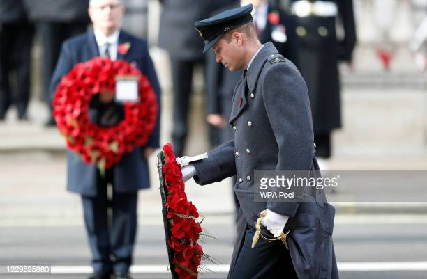 Britain's Prince William, Duke of Cambridge lays a poppy wreath during a National Service of Remembrance at the Cenotaph in Westminster, amid the...