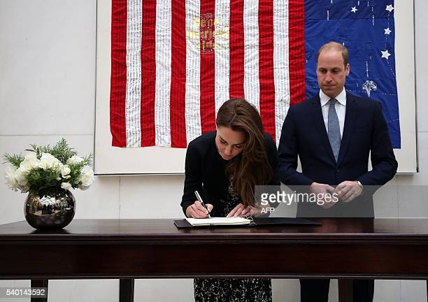 Britain's Prince William Duke of Cambridge looks on as Catherine Duchess of Cambridge signs a book of condolence for Orlando shooting victims at the...