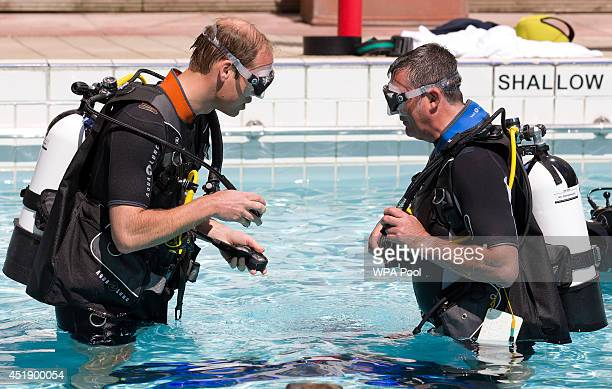 Britain's Prince William Duke of Cambridge makes safety checks with BSAC Chairman Eugene Farrell before he scuba dives with British SubAqua Club...