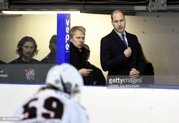 Britain's Prince William Duke of Cambridge meets Aki Riihilahti hairman of the Icehearts ice hockey club and club members on November 29 2017 in...