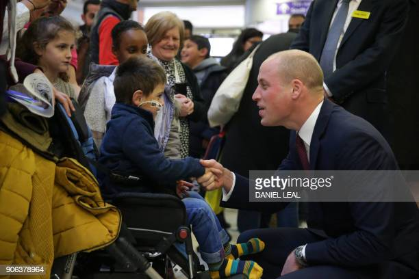 Britain's Prince William Duke of Cambridge meets patients as he visits Evelina London Children's Hospital in London on January 18 to launch a...