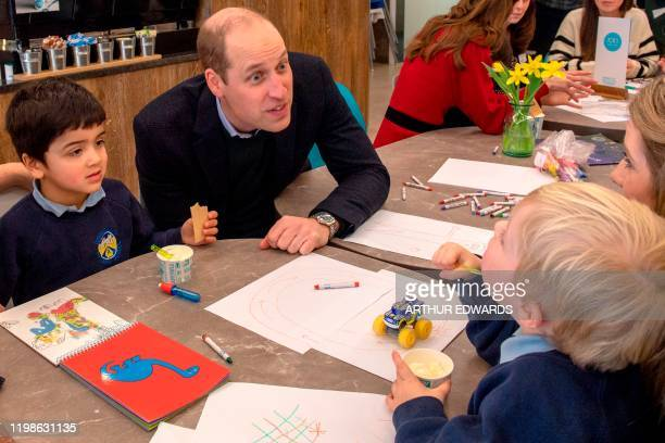 Britain's Prince William Duke of Cambridge meets with local parents and carers during his visit with his wife Britain's Catherine Duchess of...