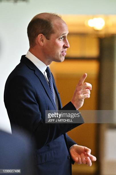 Britain's Prince William, Duke of Cambridge meets with military personnel and veterans who had been invited to watch the Ceremony of the Keys at the...