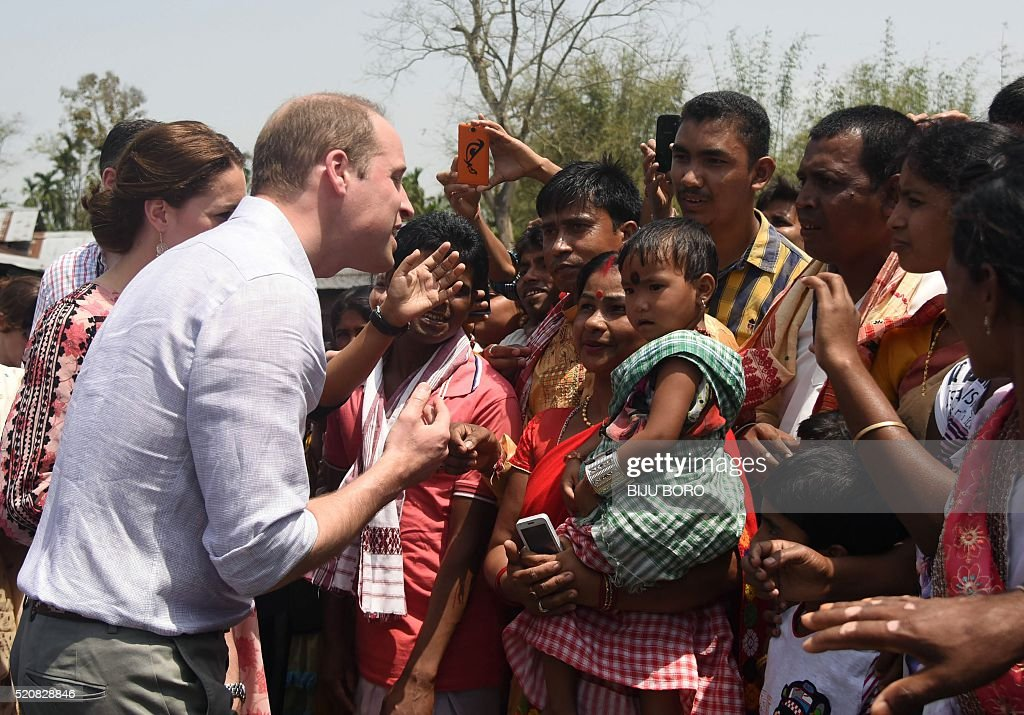 Britain's Prince William (C), Duke of Cambridge, meets with villagers in Panbari village, in Kaziranga, some 250 km from Guwahati, the capital of the north-eastern state of Assam on April 13, 2016. / AFP / Biju BORO