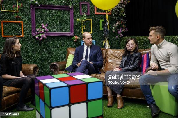 Britain's Prince William Duke of Cambridge meets YouTube vloggers Dodie Clark Nikki Lilly and Riyadh Khalaf during his visit to launch the national...