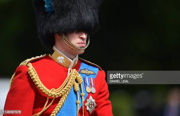 Britain's Prince William Duke of Cambridge on horseback follows Britain's Queen Elizabeth II in a horsedrawn carriage into Horseguards parade for the...