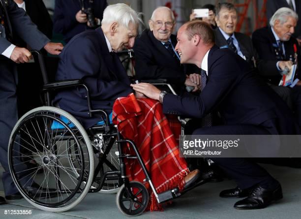 Britain's Prince William Duke of Cambridge Patron of the Battle of Britain Memorial Flight speaks with Ken Wilkinson Battle of Britain pilot at RAF...