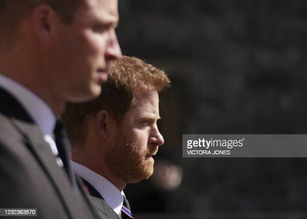 Britain's Prince William, Duke of Cambridge, Peter Phillips and Britain's Prince Harry, Duke of Sussex walk during the funeral procession of...