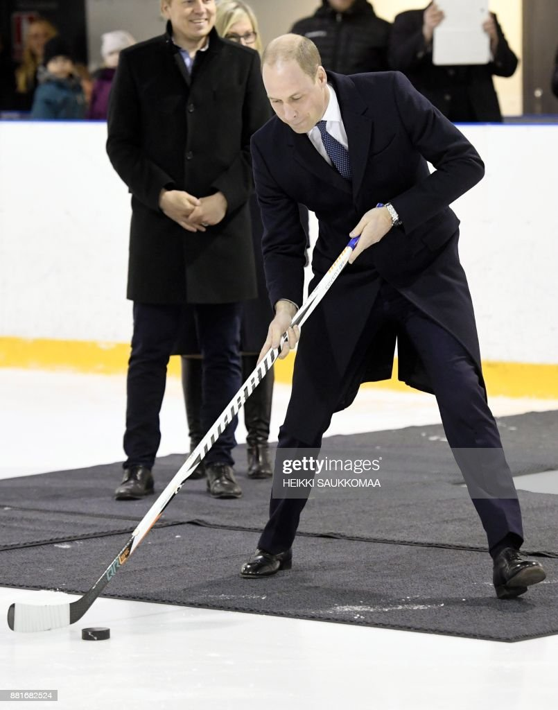 Britain's Prince William, Duke of Cambridge, prepares to shoot the puck during a meeting with members of the Icehearts ice hockey club on November 29, 2017 in Helsinki, Finland. The Icehearts is an operating model providing long-term professional growth support through team sport for children in need. / AFP PHOTO / Lehtikuva / Heikki Saukkomaa / Finland OUT