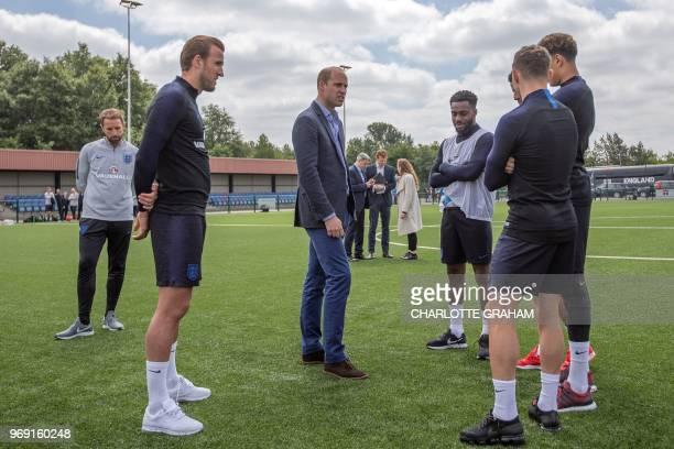 Britain's Prince William Duke of Cambridge President of the Football Association speaks with England football players England's striker Harry Kane...