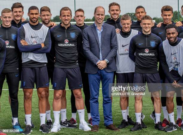 Britain's Prince William Duke of Cambridge President of the Football Association poses for a photograph with England football squad members England's...