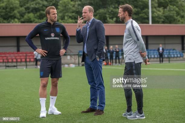 Britain's Prince William Duke of Cambridge President of the Football Association speaks with England's striker Harry Kane and England's manager...