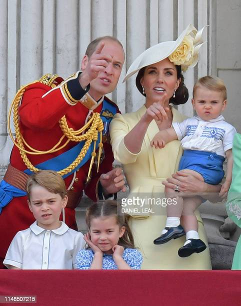 Britain's Prince William Duke of Cambridge Prince George Princess Charlotte and Britain's Catherine Duchess of Cambridge holding Prince Louis stand...