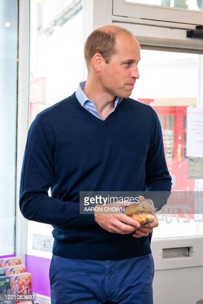 Britain's Prince William Duke of Cambridge purchases pain au chocolat during a visit to Smiths the Bakers in the High Street in King's Lynn eastern...