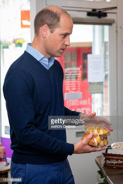 Britain's Prince William Duke of Cambridge purchases pain au chocolate during a visit to Smiths the Bakers in the High Street in King's Lynn eastern...