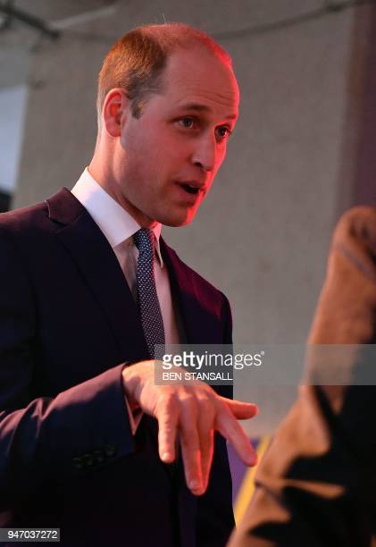 Britain's Prince William Duke of Cambridge reacts as he is shown a display of Royal Enfield motorcycles during a 'Welcome to the UK' reception on the...
