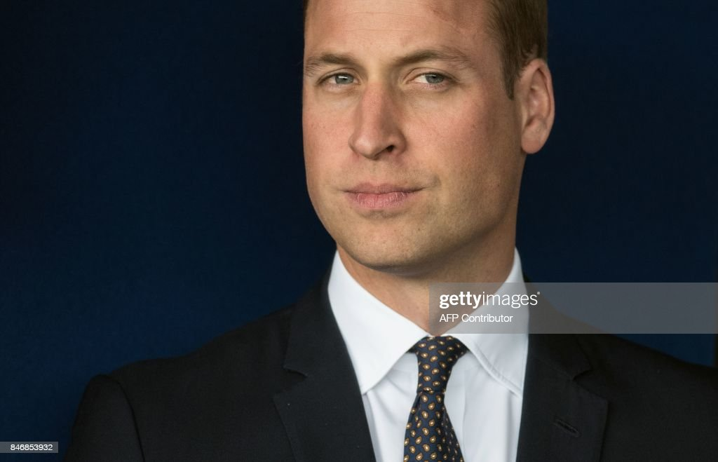 TOPSHOT - Britain's Prince William, Duke of Cambridge, reacts as he waits to unveil a plaque as he leaves after formally opening the new Urgent Care and Trauma Centre (UCAT) at Aintree University Hospital in Liverpool, north-west England on September 14, 2017. The newly redeveloped Trauma Centre includes the addition of a charity funded air ambulance helicopter landing pad. /