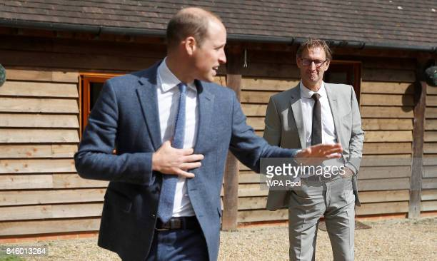 Britain's Prince William Duke of Cambridge says goodbye to former footballer and founder of the charity Sporting Chances Tony Adams at the...