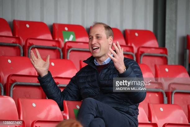Britain's Prince William, Duke of Cambridge, sits in the stands during a visit to Spartans FC's Ainslie Park Stadium in Edinburgh on May 21 to hear...