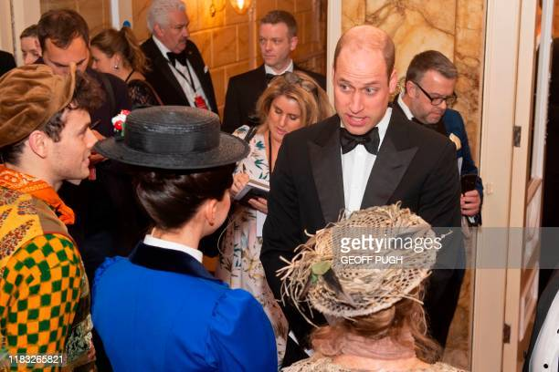 Britain's Prince William, Duke of Cambridge , speaks to the cast of Mary Poppins including Petula Clark in the beige hat as he arrives to attend the...