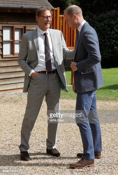 Britain's Prince William Duke of Cambridge speaks with former footballer and founder of the charity Sporting Chances Tony Adams at the residential...