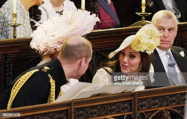 Britain's Prince William Duke of Cambridge speaks with his wife Britain's Catherine Duchess of Cambridge during the wedding ceremony of Britain's...