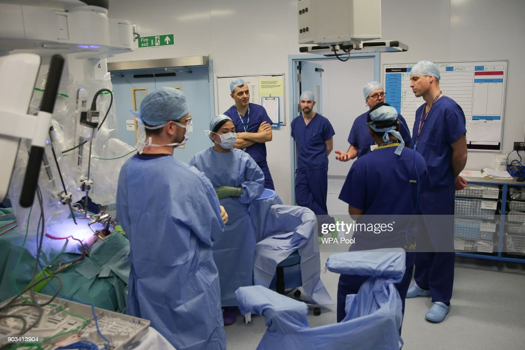 Britain's Prince William, Duke of Cambridge speaks with surgeons during a minimally invasive robotic assisted tongue base hemiglossectomy surgery with patient Anne White, 67, during his visit to The Royal Marsden Hospital on January 10, 2018 in London, England. Prince William, Duke of Cambridge was visiting the hospital to view two pioneering robotic surgeries.