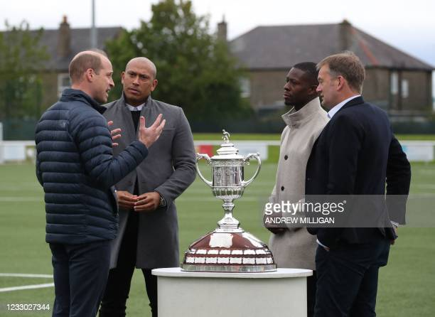 Britain's Prince William, Duke of Cambridge stands by the Scottish Cup and speaks with Scottish former professional footballer Chris Iwelumo ,...