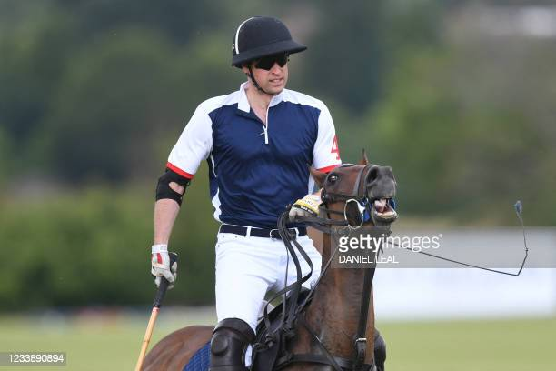 Britain's Prince William, Duke of Cambridge takes part in the Royal Charity Polo Cup 2021 match at the Guards Polo Club in Windsor, Berkshire on July...