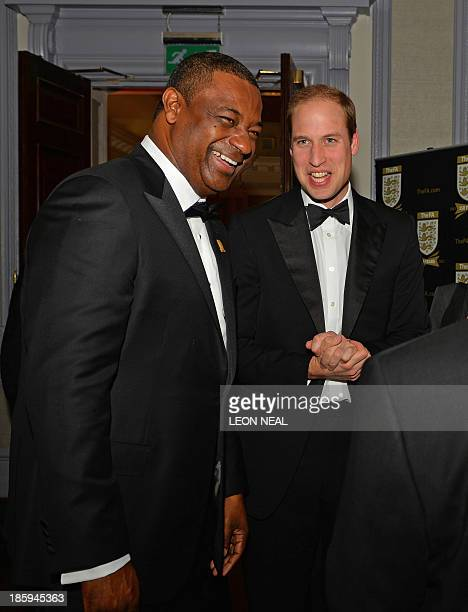 Britain's Prince William Duke of Cambridge talks to the CONCACAF president Jeffrey Webb as he attends The Football Association's 150th Anniversary...