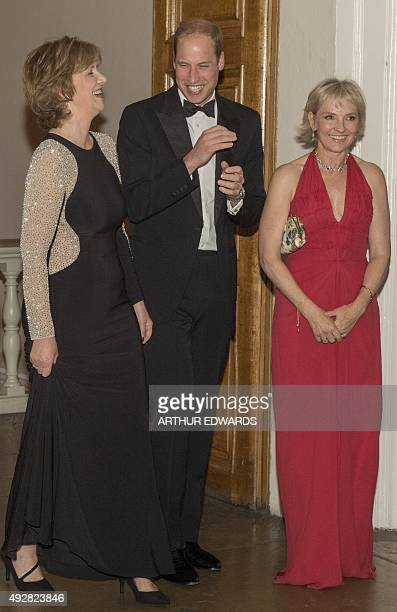 Britain's Prince William, Duke of Cambridge, talks with chief executive Ann Chalmers and founder patron Julia Samuel during a charity dinner to mark...