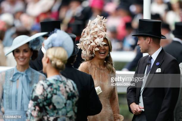 Britain's Prince William Duke of Cambridge talks with Dutch Queen Maxima on day one of the Royal Ascot horse racing meet in Ascot west of London on...