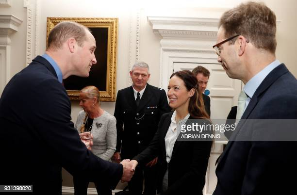Britain's Prince William Duke of Cambridge talks with police officers including PC Shaun Cartrightm who collected the Outstanding Bravery Award...