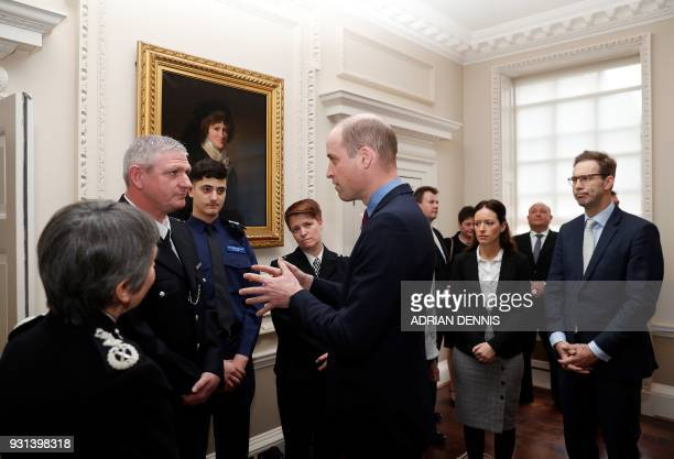 Britain's Prince William Duke of Cambridge talks with police officers including PC Shaun Cartright who collected the Outstanding Bravery Award...