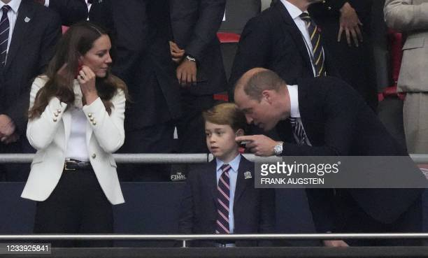 Britain's Prince William , Duke of Cambridge, talks with Prince George of Cambridge , during the UEFA EURO 2020 final football match between Italy...