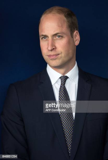 Britain's Prince William Duke of Cambridge unveils a plaque as he leaves after formally opening the new Urgent Care and Trauma Centre at Aintree...