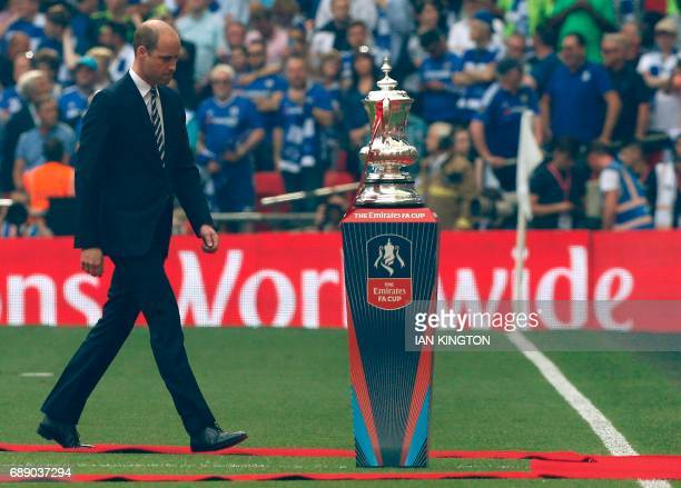 Britain's Prince William Duke of Cambridge walks past the FA Cup ahead of the English FA Cup final football match between Arsenal and Chelsea at...