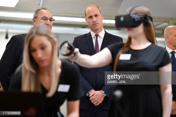 Britain's Prince William Duke of Cambridge watches a virtual reality demonstration for a mental health programme at the Oxford Science Innovation...