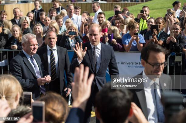 Britain's Prince William Duke of Cambridge waves as he arrives to formally open the new Urgent Care and Trauma Centre at Aintree University Hospital...