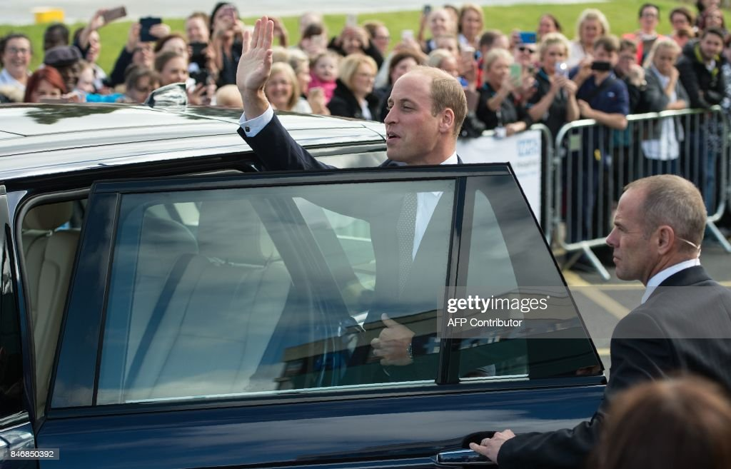 Britain's Prince William, Duke of Cambridge, waves as he leaves after formally opening the new Urgent Care and Trauma Centre (UCAT) at Aintree University Hospital in Liverpool, north-west England on September 14, 2017. The newly redeveloped Trauma Centre includes the addition of a charity funded air ambulance helicopter landing pad. /