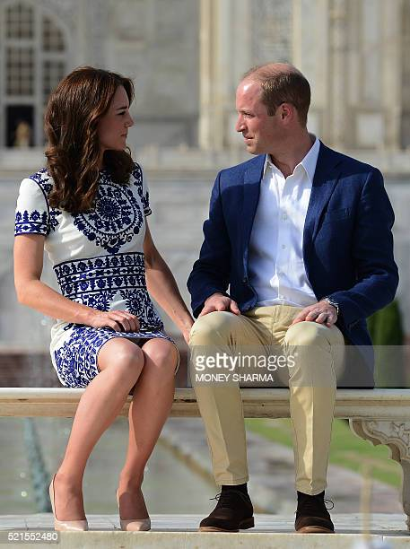 Britain's Prince William Duke of Cambridgeand Catherine Duchess of Cambridge pose during their visit to The Taj Mahal in Agra on April 16 2016 Prince...