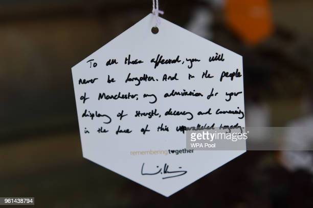 Britain's Prince William Duke of Cambridge's own personal message of support hangs from the 'tree of hope' a memorial set up for the Manchester Arena...