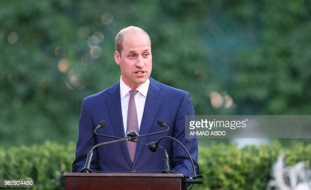 Britain's Prince William gives a speech during a birthday party in honour of his grandmother Queen Elizabeth II at the residence of the British...