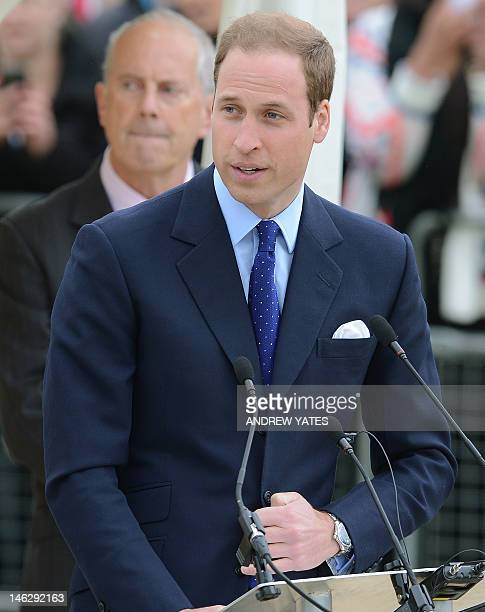Britain's Prince William gives a speech during a visit to Vernon Park in Nottingham central England on June 13 2012 with Britain's Queen Elizabeth II...