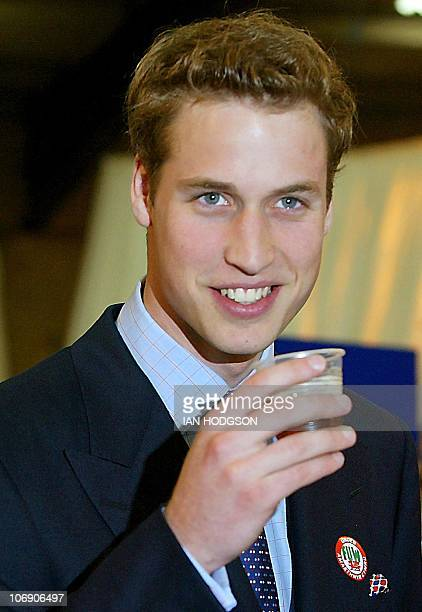 Britain's Prince William has a drink of beer on a visit to the Anglesey Agricultural centre in Anglesey Wales 19 June 2003 Prince William is taking...
