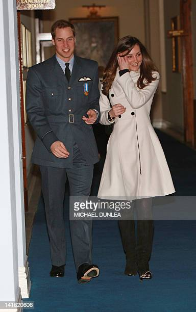 Britain's Prince William is pictured with his girlfriend Kate Middleton after his graduation ceremony at RAF Cranwell air base in Lincolnshire, on...