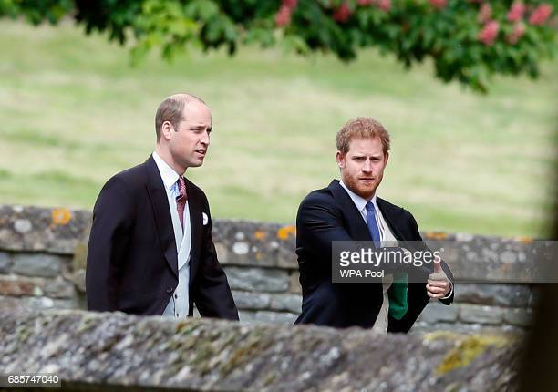 Britain's Prince William, left, and his brother Prince Harry arrive for the wedding of Pippa Middleton and James Matthews at St Mark's Church on May...