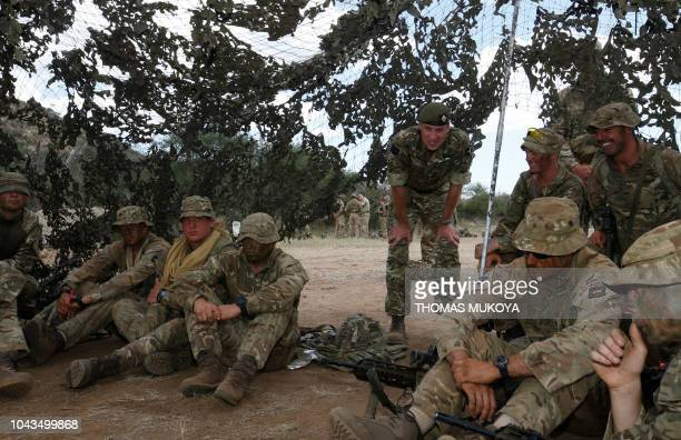 Britain's Prince William listens to Irish Soldiers during his visit to the 1st Battalion the Irish Guards Battle group training under the British...