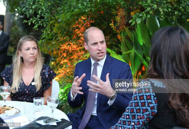 Britain's Prince William meets Jordanians working in the education sector during a birthday party in honour of his grandmother Queen Elizabeth II at...