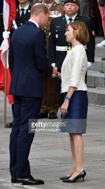 Britain's Prince William shakes hands with French Defence Minister Florence Parly in Amiens northern France on August 8 as he arrives to attend a...